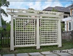 This freestanding trellis/pergola looks great while effectively screening the ba. - This freestanding trellis/pergola looks great while effectively screening the back yard from the vi -