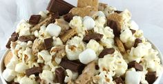 S'mores Popcorn - salty popcorn, sweet marshmallows, crunch graham crackers and don't forget the chocolate.  Mmm ..mmm good.