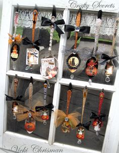 vintage spoons, altered and hung in an old window frame.  So sweet!