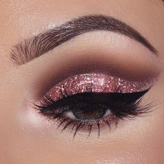 """V-day look @smoldercosmetics """"baby talk"""" glitter @smoldercosmetics """"pink gold"""" loose glam dust @tartecosmetics tarteist clay paint liner @tartecosmetics shape tape contour concealer in light-medium @anastasiabeverlyhills dipbrow+brow powder duo in dark brown @hudabeauty @shophudabeauty scarlet lashes @toofaced chocolate bar palette @misaki_cosmetics dazzling color green lenses @benefitcosmeticsgreece @benefitcosmetics roller lash mascara"""