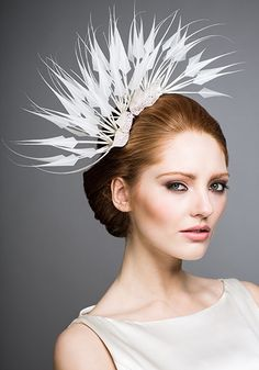 Rachel Trevor Morgan - Bridal Couture. Cut feather headdress with crystal leaves. #passion4hats