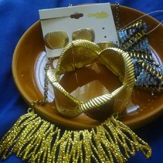 Assorted Costume Jewelry (2)Braclets Necklace (3) Large size 9 rings (1) Necklace Jewelry