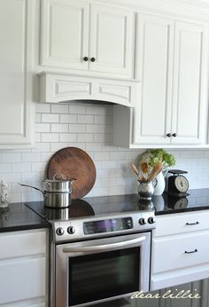 gorgeous simple hood, and herringbone pattern title backsplash