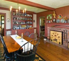 An early 18th-century New England keeping room was the model for a showroom with a vertical-board fireplace wall.