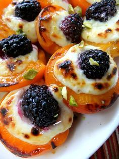 Roasted apricots, with mascarpone and blackberry drizzled with honey.