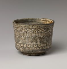 Tea bowl with decoration of chrysanthemums and wavy lines, Joseon dynasty (1392–1910), first half of the 17th century. Culture: Probably Korea - Stoneware with stamped, white-slip design KOREAN ANTIQUES AND ART : More At FOSTERGINGER @ Pinterest