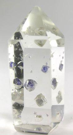 Quartz with Fluorite inclusions.