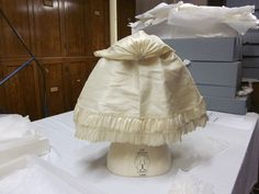 Cape Date: ca. 1770 (made) Museum number: T.37-1958 Descriptive line English; Ivory, silk, scalloped and pinked trim, hooded | V&A