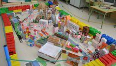 maqueta escolar de ciudad a gran escala con cajas y papel