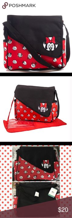 """~ Disney Minnie Mouse Diaper Bag & Changing Mat A magical way to store baby girl's essentials. Features a spacious interior with two mesh pockets and one zip pocket. The exterior features a Minnie Mouse and Friends print with two side pockets. Complete with an accessory pouch and changing pad.  Snap flap closure Spacious interior Adjustable shoulder strap 5 storage pockets Changing pad Synthetic materials Dimensions: 12"""" H x 14"""" W x 4.5"""" D Disney Bags Baby Bags"""