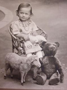 Vintage photo of a child with her toys...A Teddy Bear and Lamb.