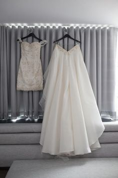 Such a gorgeous convertible wedding dress!  The short dress is for the reception and then a full ballgown over skirt gets added for the wedding ceremony!