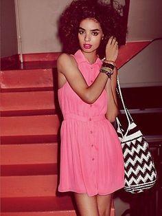 pink dress, zig zag bag, curls