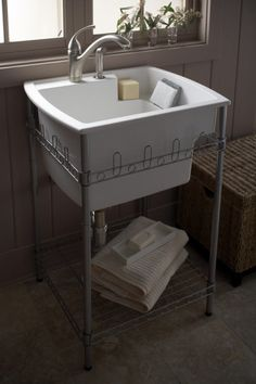 Splash Galleries Sterling 995-U Latitude Laundry Sink and Stand. Raleigh, NC Kitchen & Bath Showroom 919-719-3333.