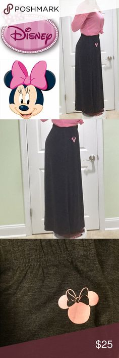 Disney Skirt This is a long cotton maxi skirt from Disney. It has an elastic band, Never worn, Super Comfy! Has a light pink Minnie logo at the top. Disney Skirts Maxi