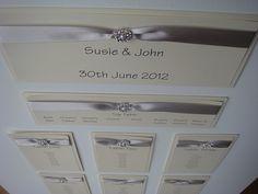 vintage pearl wedding seating table plan in silver