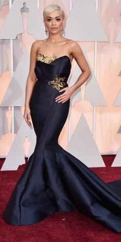 Rita Ora in a black & gold embellished strapless mermaid gown by Marchesa with Lorraine Schwartz jewels.