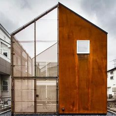 Powdered iron was mixed with plaster to give this Tokyo house a rusted exterior that will weather over time: www.dezeen.com/?p=514123   #architecture