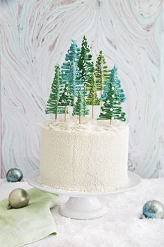 A forest of tiny, candy trees makes a festive cake topper.