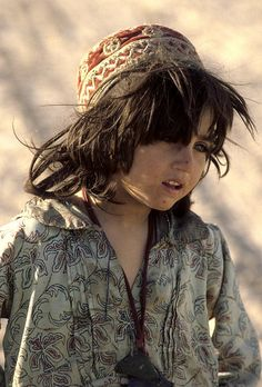 Portrait of an Afghan child at Roghani Refugee Camp in Chaman, a Pakistani border town. Children and young people make up a large percentage of the population at the camp