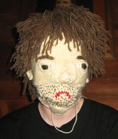 Tumblr user Damp Room posted some great images of a knitted mask designed to make the wearer look like a hungover man.