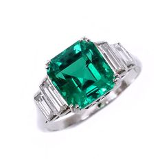 Art Deco single stone Columbian emerald and diamond ring, c.1925, the square cut-cornered emerald weighing 3.08ct,  to twin stepped baguette-cut diamond shoulders, mounted in platinum, accompanied by report no. CS46967 from The American Gemological Laboratories (AGL), stating that the emerald is of Colombian origin and with no clarity enhancement