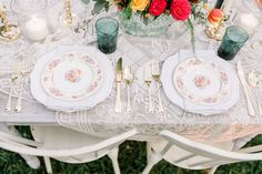 Vineyard Wedding with pretty floral vintage china, gold flatware and lace.