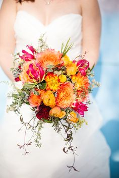 The pop of color against the white dresses is always stunning, so for a bride who wants something a little different , lets talk color!