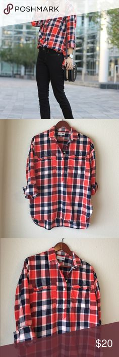 """Orange/Blue Boyfriend Plaid Shirt The perfect fall shirt 🍁 Vibrant orange and navy blue plaid popover style shirt. Buttons down a quarter of the way. Sleeves can be worn rolled up or down, I wore them rolled up 😊 Slightly shorter in the front. Super comfy oversized boyfriend fit. Only worn twice, perfect condition! Cover pic via simplysutton.com 🤗  Size: Small but can fit a medium as well. Measurements: 19"""" across, 24-27"""" length Condition: Like new  🚫Trades  Please ask any questions…"""