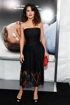 """46-year-old Salma Hayek sizzled in a strapless Stella McCartney creation as she made her way into the New York City premiere of """"Here Comes the Boom"""" on Tuesday evening. The hot mama -- who recently told Harper's Bazaar that she avoids Botox, not carbohydrates -- paired her lacy look with Brian Atwood peep-toes and a pop of color, courtesy of a Bottega Veneta clutch. (10/9/2012)"""