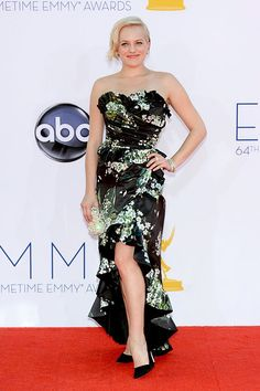 Mad Men star Elisabeth Moss looked incredible in a black floral Dolce & Gabbana gown.