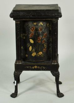 Tole rotating plate warmer with floral painted decoration and cast iron paw feet, late 19th C.