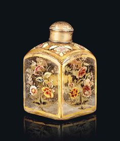 A MUGHAL ENAMELLED AND GILT CLEAR GLASS PERFUME BOTTLE