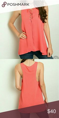 Coral Trapeze Tank NWT sizes S & M Comes in either a size small or a size medium! Beautiful coral trapeze tank BRAND NEW with tags! Gorgeous peace for sure ...also compliments with any bottom!  + VS FREEBIES aswell w any purchase!! Boutique 9 Tops Tank Tops