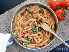 Creamy Tomato & Spinach Pasta  Ingredients : 1 Tbsp olive oil 1 small onion  2 cloves garlic  1 (15 oz.) can diced tomatoes ½ tsp dried oregano ½ tsp dried basil  pinch red pepper flakes (optional) freshly cracked pepper to taste ½ tsp salt  2 Tbsp tomato paste 2 oz. cream cheese ¼ cup grated Parmesan ½ lb. penne pasta ½ (9 oz.) bag fresh spinach