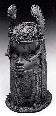 Head of an Oba  Date:     19th century Geography:     Nigeria, Court of Benin Culture:     Edo peoples Medium:     Brass (cast) Metropolitan Museum