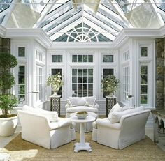 an English Conservatory sun room.  Imagine reading a book or having tea in here with rain hitting the roof.    I must win the lotto so I can have this