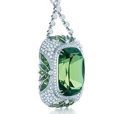 Tiffany pendant with a cushion-cut tsavorite and an Art Deco motif of leaves with diamonds in platinum, from the 2013 Blue Book Collection.