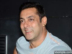Salman Khan smiling while talking to reporters. via Voompla.com