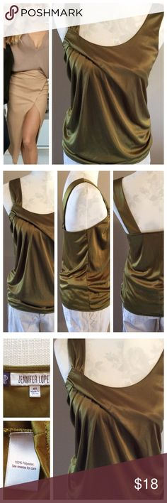 "Jeweled Tone Tank Jennifer Lopez designed this fabulous tank! Jewel toned army green color with folded and fastened detailing that makes this tank stand out from the rest. Wide shoulder straps and a loose fitted waist. Size XS, Measurements when laying flat: 15"" chest and 24"" length. Excellent condition. Jennifer Lopez Tops Tank Tops"