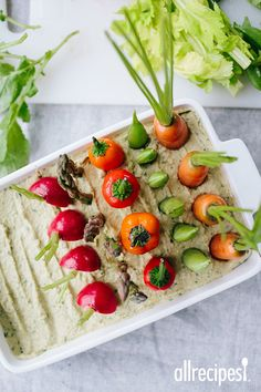 "Spring Herb Hummus Vegetable Garden | ""Vegetable platters need not look all look the same. Here, fresh spring vegetables sit in an herb-laced hummus to resemble a spring garden in full bloom."""