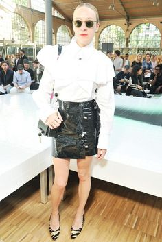 On Chloë Sevigny: Kenzo Ruffled Cotton Poplin Shirt (£389), Fringed Vinyl Skirt (£424), bag and shoes.