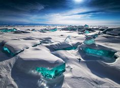 Turquoise ice in Northern Lake Baikal, Russia.