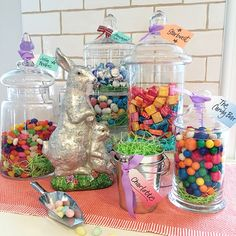 This Easter set up a CANDY BAR. Terrarium glass jars from HomeGoods serve as the perfect whimsical shaped containers. Our favorite candy fills each jar. Each child (and adult) gets to fill his or her own bag or tin container. These terrarium jars would be perfect for candles, cookies, snacks, craft supplies, bath accessories, succulents and anything else you can imagine after Easter.  Sponsored Happy By Design post.