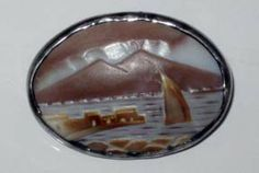 Mt. Etna volcano scene carved shell cameo brooch in .800 Silver mounting.
