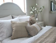 love the white and tan bedding