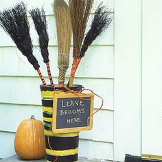 "Paint a metal planter and add a chalkboard message for this cute ""broomstick parking"" sign at your Halloween party."