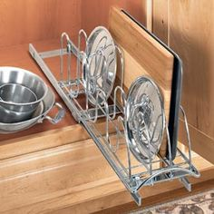 Pull-out organizer holds 18 lids - or get creative and store baking sheets, cutting boards and serving trays, too.