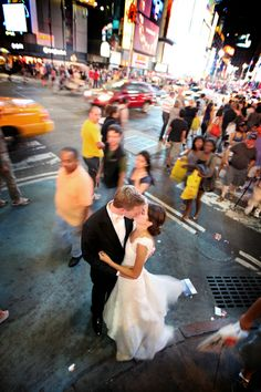 """CITY BUSTLE. Fun, urban idea for wedding photography location. Steal a kiss in the midst of the hustle and bustle of the city. North Michigan Avenue (Magnificent Mile) or State Street (especially lit up at night by Chicago Theater Sign) would be great, busy locations. Love the """"frozen in time"""" feel. Wedding photos; wedding photography; wedding photo ideas; Chicago wedding photography locations. #WeddingPhotos #WeddingPhotography"""