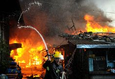 Firefighters battle a fire in Manila photograph by Noel Celis/AFP/Getty Images